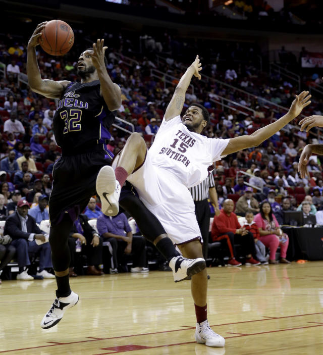 Texas Southern's D'Angelo Scott (15) falls backward while reaching for a rebound with Prairie View A&M's Demondre Chapman (32) during the first half of an NCAA college basketball game in the championship of the Southwestern Athletic Conference tournament Saturday, March 15, 2014, in Houston. (AP Photo/David J. Phillip)