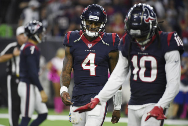 Houston Texans quarterback Deshaun Watson (4) and wide receiver DeAndre Hopkins (10) walk off the field after they failed to score a touchdown against the Dallas Cowboys during the second half of an NFL football game, Sunday, Oct. 7, 2018, in Houston. (AP Photo/Eric Christian Smith)
