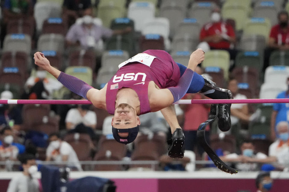 Sam Grewe of the United States warms up before the men's high jump T63 final during the Tokyo 2020 Paralympics Games at the National Stadium in Tokyo, Japan, Tuesday, Aug. 31, 2021. (AP Photo/Eugene Hoshiko)