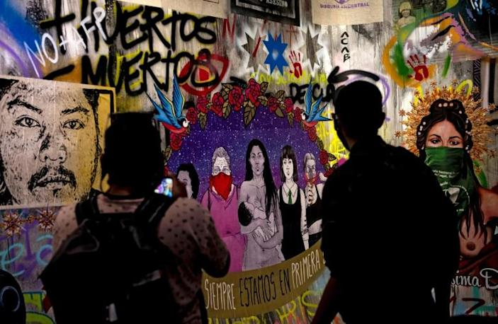 People visit the Social Uprising Museum, which exhibits street art from the months of anti-government protests that rocked Chile