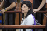 FILE - This May 21, 2015 file photo shows Palestinian Parliament member Khalida Jarrar of the Popular Front for the Liberation of Palestine (PFLP) attending a court session at the Israeli Ofer military base near the West Bank city of Ramallah. Palestinian activists and human rights groups have called on Israel to allow the prominent jailed lawmaker to attend her daughter's funeral on Tuesday, July 13, 2021.(AP Photo/Majdi Mohammed, File)
