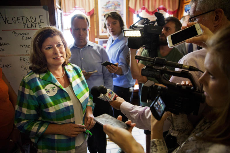 Karen Handel, Republican candidate for Georgia's 6th congressional district talks to reporters during a campaign stop at Old Hickory House in Tucker, Ga., Monday, June 19, 2017. The race between Handel and Democrat Jon Ossoff is seen as a significant political test for the new Trump Administration. The district traditionally goes Republican, but most consider the race too close to call as voters head to the polls on Tuesday. (AP Photo/David Goldman)