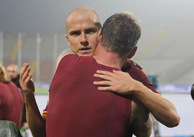 Roma's Michael Bradley, face to camera, of the United States, celebrates with teammates Daniele De Rossi, at the end of the Serie A soccer match between Udinese and Roma, at the Friuli Stadium in Udine, Italy, Sunday, Oct. 27, 2013. Bradley scored the winning goal as Roma won 1 - 0. (AP Photo/Paolo Giovannini)