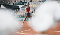 Poland's Iga Swiatek plays a return to Slovenia's Kaja Juvan during their first round match on day two of the French Open tennis tournament at Roland Garros in Paris, France, Monday, May 31, 2021. (AP Photo/Thibault Camus)