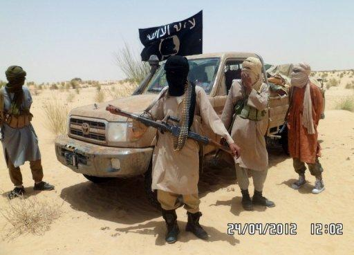 Islamist rebels of Ansar Dine are pictured near Timbuktu, in rebel-held northern Mali on April 24. A newly formed group of armed Arab fighters tightened its grip on the northern Malian desert city of Timbuktu on Friday, witnesses said