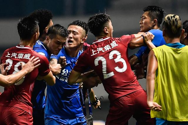 The brawl erupted after Shanghai SIPG playmaker Oscar appeared to fire the ball deliberately at Guangzhou players (AFP Photo/STR)