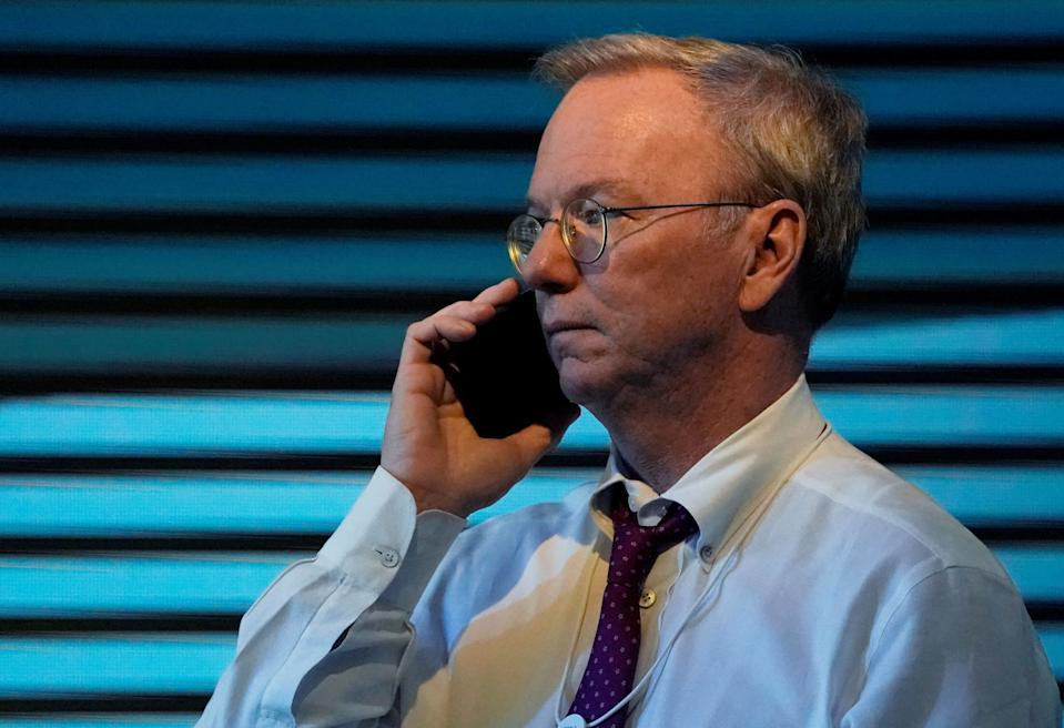 Former Alphabet's Executive Chairman Eric Schmidt speaks on the phone during the World Economic Forum (WEF) annual meeting in Davos, Switzerland January 24, 2018.  REUTERS/Denis Balibouse