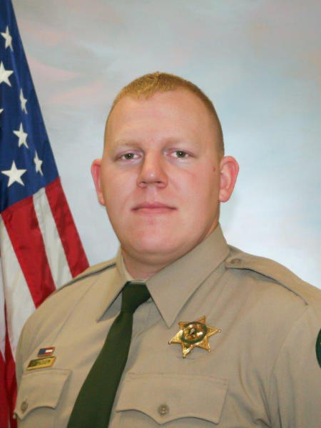 FILE - This undated photo shows Cowlitz County Sheriff's Office Deputy Justin DeRosier, who was shot and killed Saturday, April 13, 2019. A funeral procession for the slain sheriff's deputy from Washington state has begun. The procession Wednesday, April 24, 2019, will bring the body of DeRosier from Longview, Wash. to Portland, Ore., where thousands of law enforcement officers will attend his funeral. (Cowlitz County Sheriff's Office via AP, File)
