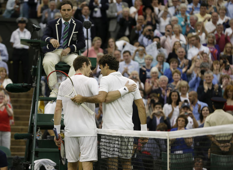 Andy Murray of Britain, left, congratulates Roger Federer of Switzerland after he won the men's singles final match at the All England Lawn Tennis Championships at Wimbledon, England, Sunday, July 8, 2012. (AP Photo/Kirsty Wigglesworth)