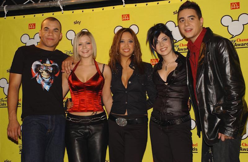 EDITORIAL USE ONLY : Pop group HearSay (L-R) Danny, Suzanne, Myleene, Kim and Noel) at the Disney Channel Kids Awards 2001, held at the London Arena in Docklands. Hear'Say won the new chart shaker award.