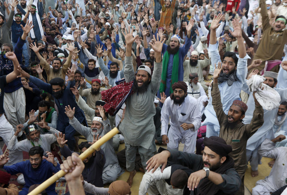 Supporters of Tehreek-e-Labiak Pakistan, a banned Islamist party, chant slogans during a protest on the arrest of their party leader Saad Rizvi, who was demanding the government to expel French ambassador, in Lahore, Pakistan, Monday, April 19, 2021. The outlawed Pakistani Islamist political group freed 11 policemen almost a day after taking them hostage in the eastern city of Lahore amid violent clashes with security forces, the country's interior minister said Monday. (AP Photo/K.M. Chaudary)