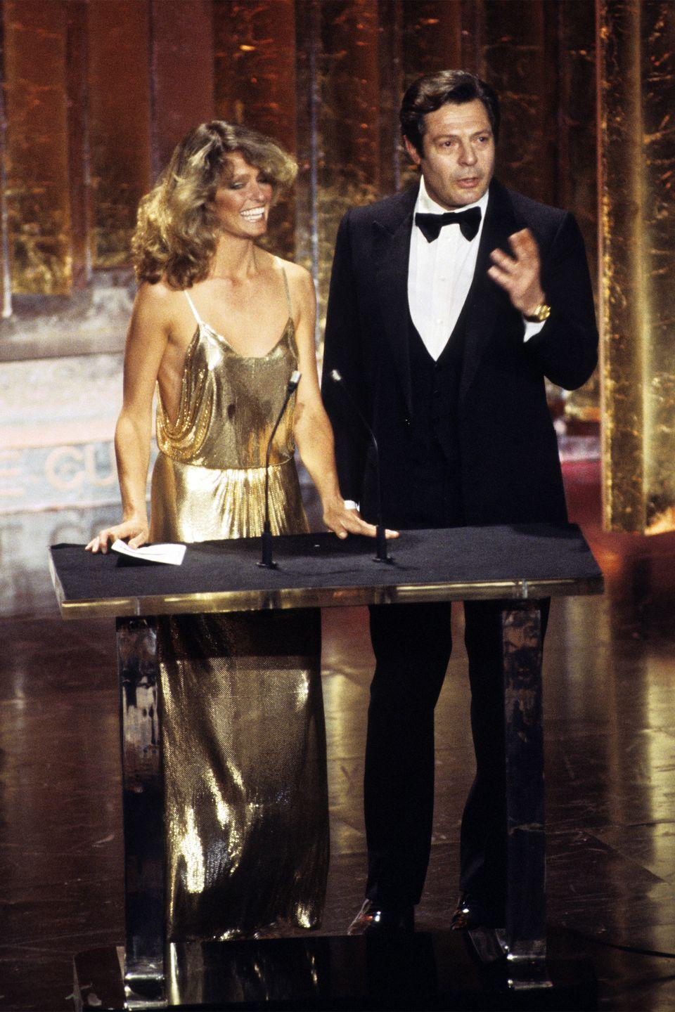 <p>Farrah Fawcett was the golden girl of the ceremony, her gilded Stephen Burrows gown spawned a million replicas for the disco set. </p>