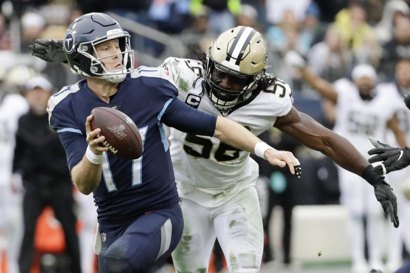 Tennessee Titans quarterback Ryan Tannehill (17) is sacked for a 10-yard loss by New Orleans Saints outside linebacker Demario Davis (56) in the first half of an NFL football game Sunday, Dec. 22, 2019, in Nashville, Tenn. (AP Photo/James Kenney)