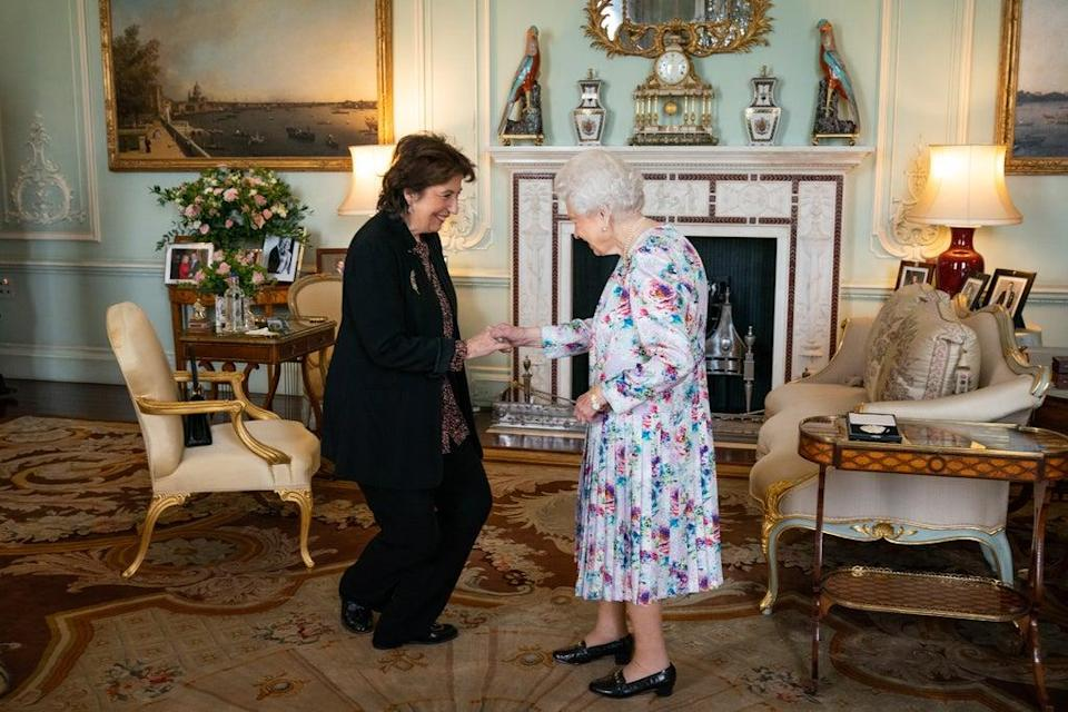 Dame Imogen Cooper curtseys to the Queen (Aaron Chown/PA) (PA Wire)