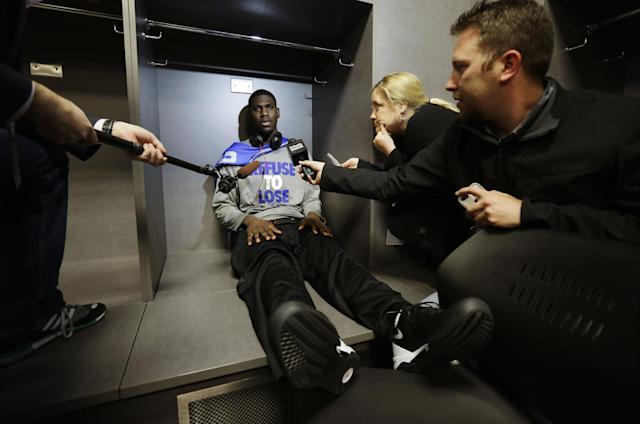 Kentucky forward Alex Poythress is interviewed in the locker room before practice for the NCAA Final Four tournament college basketball championship game Sunday, April 6, 2014, in Arlington, Texas. Kentucky plays Connecticut in the championship game on Monday, April 7. 2014. (AP Photo/Eric Gay)
