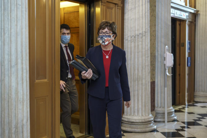 Sen. Susan Collins, R-Maine, arrives for votes during a rare weekend session to advance the confirmation of Judge Amy Coney Barrett to the Supreme Court, at the Capitol in Washington, Sunday, Oct. 25, 2020. (AP Photo/J. Scott Applewhite)
