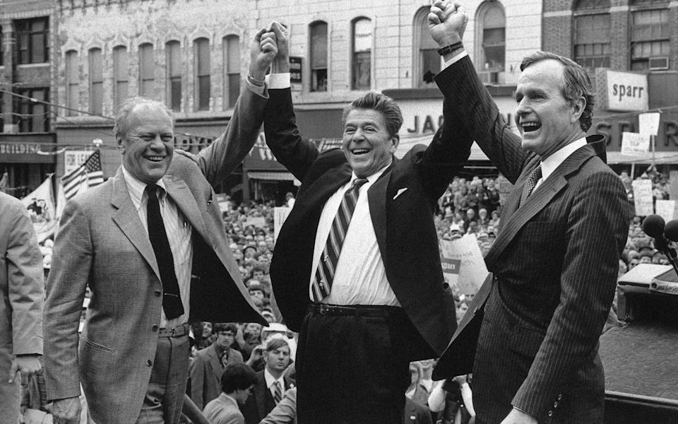"""<span class=""""caption"""">The U.S. politics of care changed under Ronald Reagan shown here on Nov. 3, 1980, with former president Gerald Ford and his running mate, George H.W. Bush in Peoria, Ill.</span> <span class=""""attribution""""><span class=""""source"""">(AP Photo)</span></span>"""