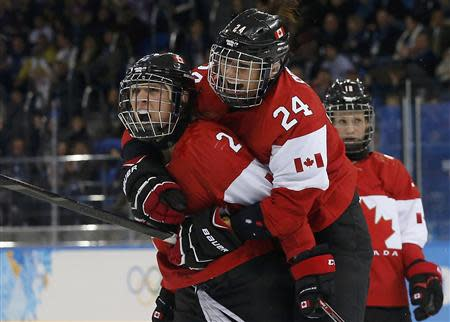 Canada's Meghan Agosta-Marciano (2) celebrates her goal with teammate Natalie Spooner (R) after scoring against Team USA during the third period of their women's ice hockey game at the Sochi 2014 Sochi Winter Olympics, February 12, 2014. REUTERS/Jim Young