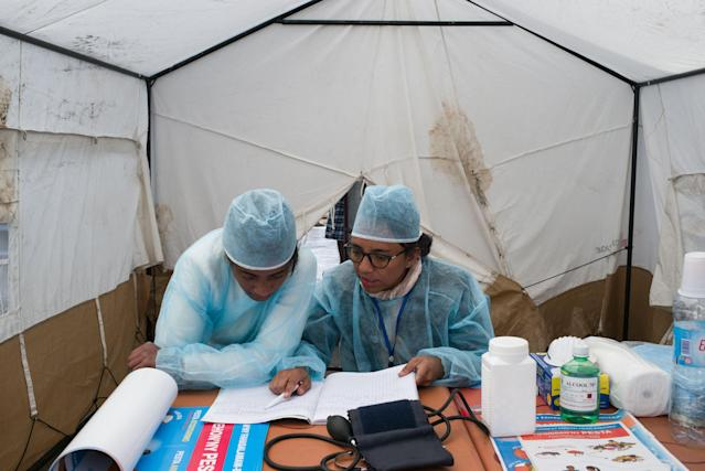 Doctors and nurses work at a health care checkpoint in Madagascar in an attempt to educate travelers and potentially detect cases of pneumonic plague. (Photo: Getty Images)