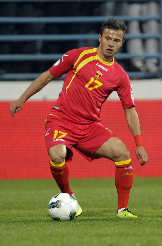 Montenegro's Elsad Zverotic controls the ball during their 2014 World Cup group H qualifying soccer match against Montenegro, at City Stadium in Podgorica, Montenegro, Tuesday, March 26, 2013. (AP Photo/Darko Vojinovic)