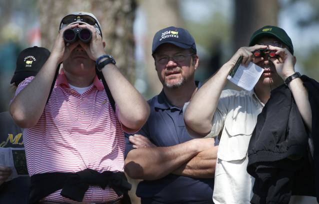 Patrons watch play on the ninth hole during the first round of the Masters golf tournament at the Augusta National Golf Club in Augusta, Georgia April 10, 2014. REUTERS/Mike Segar (UNITED STATES - Tags: SPORT GOLF)