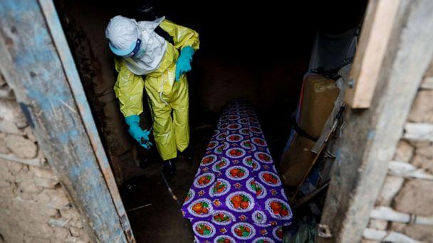 PHOTO: A healthcare worker, who volunteered in the Ebola response, sprays the coffin of a 85-year-old woman suspected of dying of Ebola, outside her house in Beni, in the Democratic Republic of Congo, Oct. 8, 2019. (Zohra Bensemra/Reuters)