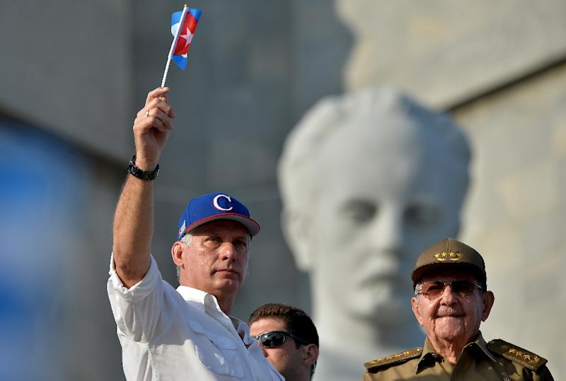 Miguel Diaz-Canel's (L) first year as president of Cuba has been anything but straightforward
