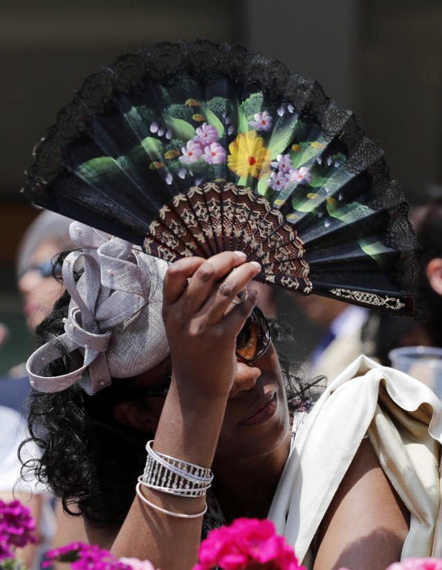 Britain Horse Racing - Royal Ascot - Ascot Racecourse - June 21, 2017 A spectator waves a fan during the races REUTERS/Eddie Keogh Livepic