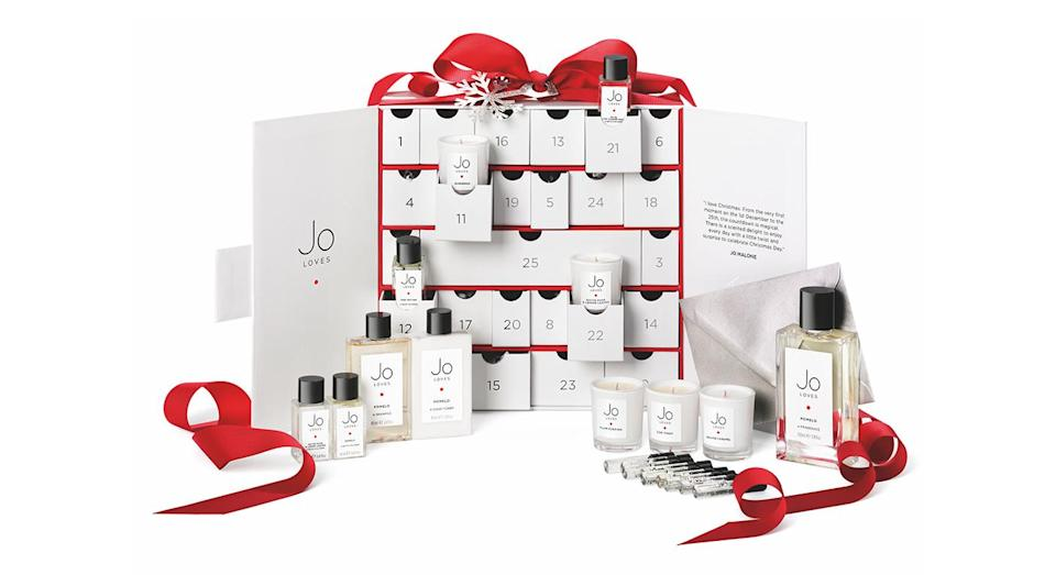 """<p>Perfume fanatics, we've found just the one for you. Priced at £250, the first beauty advent calendar from Jo Loves (a spin-off brand from Jo Malone) features 24 minature goodies. On Christmas Day, you can even trade in a token for your favourite 100ml scent. Merry Christmas! Available <a rel=""""nofollow noopener"""" href=""""https://www.joloves.com/"""" target=""""_blank"""" data-ylk=""""slk:online"""" class=""""link rapid-noclick-resp"""">online</a> and in store from November 5. </p>"""