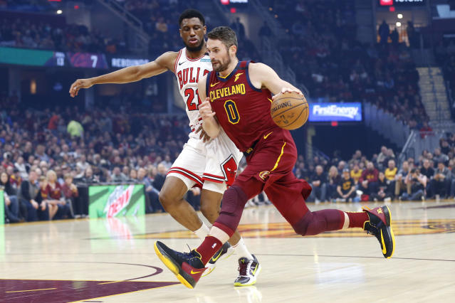 Cleveland Cavaliers' Kevin Love (0) drives on Chicago Bulls' Thaddeus Young (21) in the first half of an NBA basketball game, Saturday, Jan. 25, 2020, in Cleveland. (AP Photo/Ron Schwane)