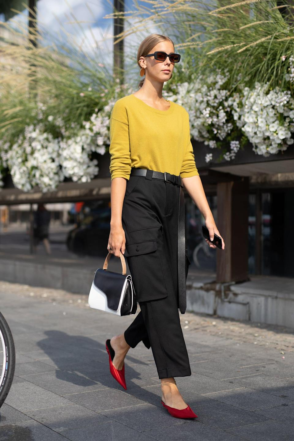 <p>In a cropped cut and understated color (like good ol' basic black), cargos are just as streamlined as your favorite slim-fit trousers, albeit infinitely cooler. Top them with an easy knit and finish with style-forward mules. </p>
