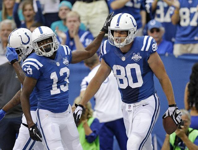 Indianapolis Colts' Coby Fleener (80) is congratulated by T.Y. Hilton (13) after scoring on a 3-yard touchdown reception during the first half an NFL football game against the Miami Dolphins Sunday, Sept. 15, 2013, in Indianapolis. (AP Photo/AJ Mast)