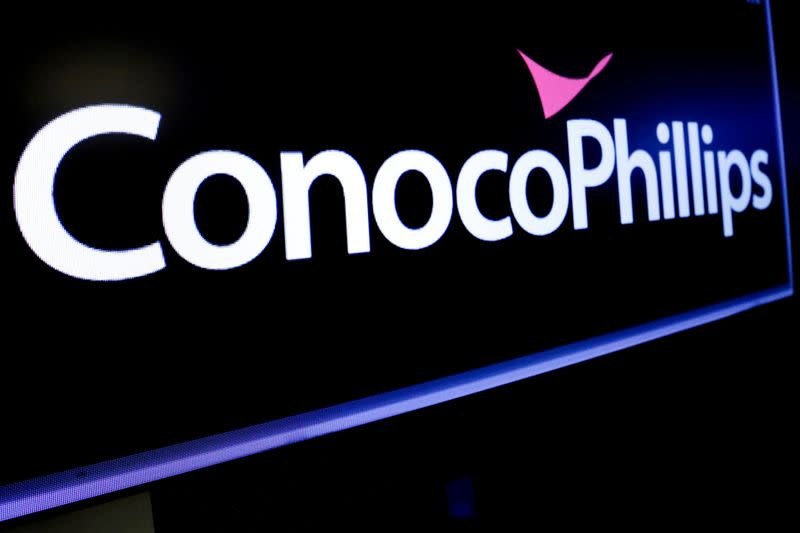 FILE PHOTO:  The logo for ConocoPhillips is displayed on a screen on the floor at the NYSE in New York