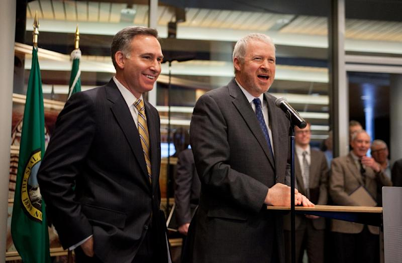 King County executive Dow Constantine, left, and Seattle Mayor Mike McGinn speak during a news conference on Thursday, Feb. 16, 2012, at Seattle City Hall where they announced a possible deal on a new arena for an NBA team and NHL team to be built in Seattle. (AP Photo/seattlepi.com, Joshua Trujillo)  SEATTLE TIMES OUT; MAGAZINES OUT; NO SALES