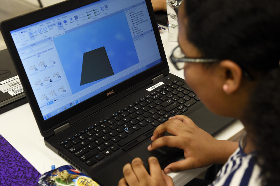 DENVER, CO - MARCH 15: Neah Murphy designs a game in Roblox during Roblox Game Designers Club at Montbello Library on March 15, 2017, in Denver, Colorado. The Montbello Library Branchs IdeaLAB has really been taking off since starting up. The ideaLAB is a community technology center geared toward students. (Photo by Seth McConnell/The Denver Post via Getty Images)