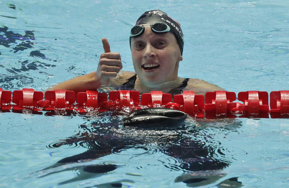 Katie Ledecky gives a thumbs up in the pool after a race.