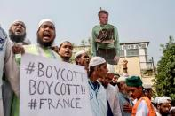 Supporters and activists of the Islami Andolan Bangladesh take part in a protest calling for the boycott of French products and to denounce the French President Emmanuel Macron for his comments over a cartoon of Prophet Mohammad in Dhaka