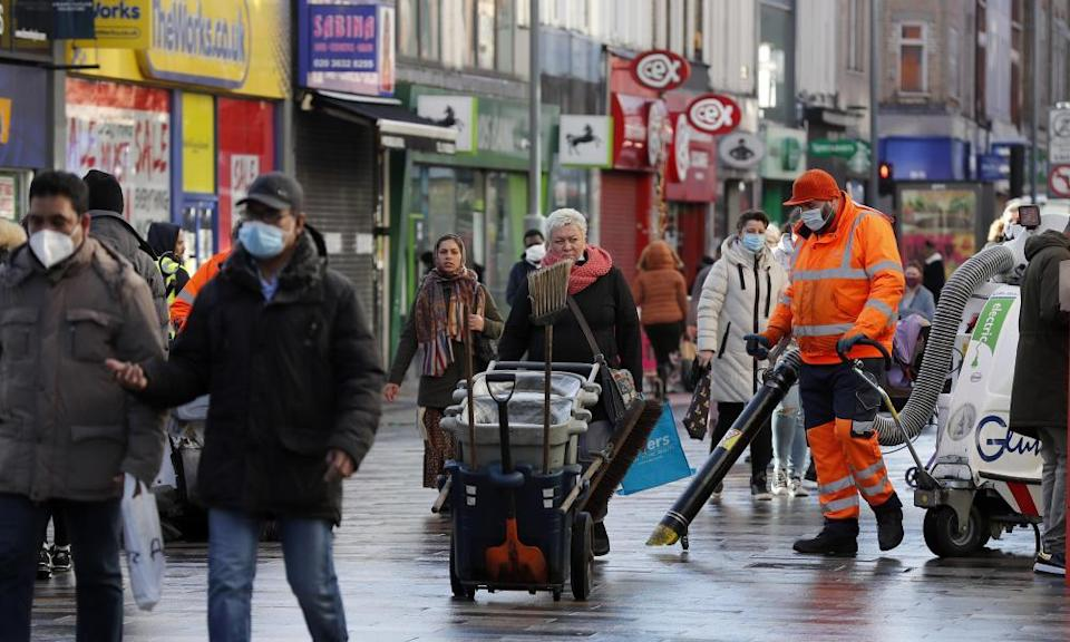 Road cleaners in the town centre of Ilford in the borough of Redbridge