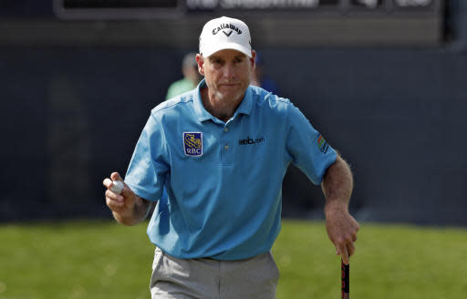 Jim Furyk holds up his ball after putting out on the ninth hole during the second round of The Players Championship golf tournament Friday, March 15, 2019, in Ponte Vedra Beach, Fla. (AP Photo/Lynne Sladky)