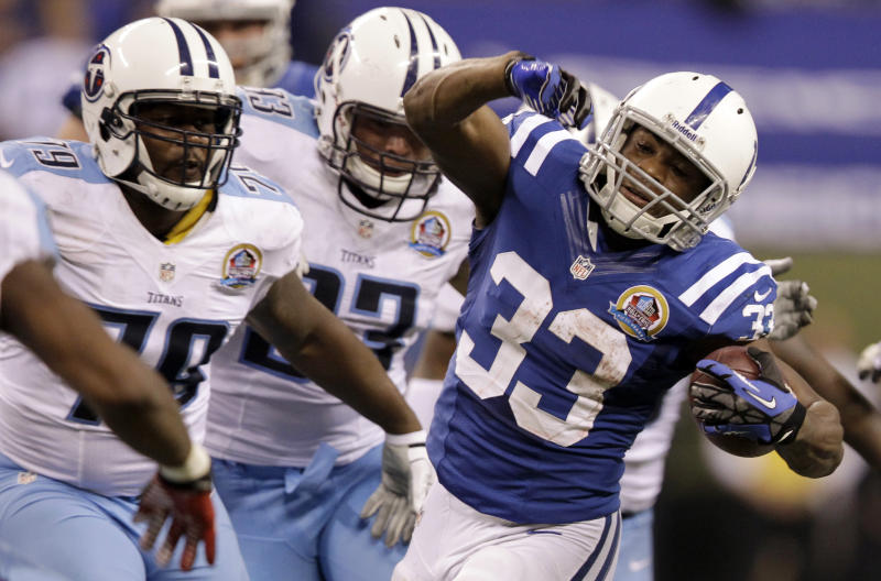 Indianapolis Colts' Vick Ballard (33) is chased by Tennessee Titans' Jarius Wynn (79) during the second half of an NFL football game, Sunday, Dec. 9, 2012, in Indianapolis. (AP Photo/Michael Conroy)