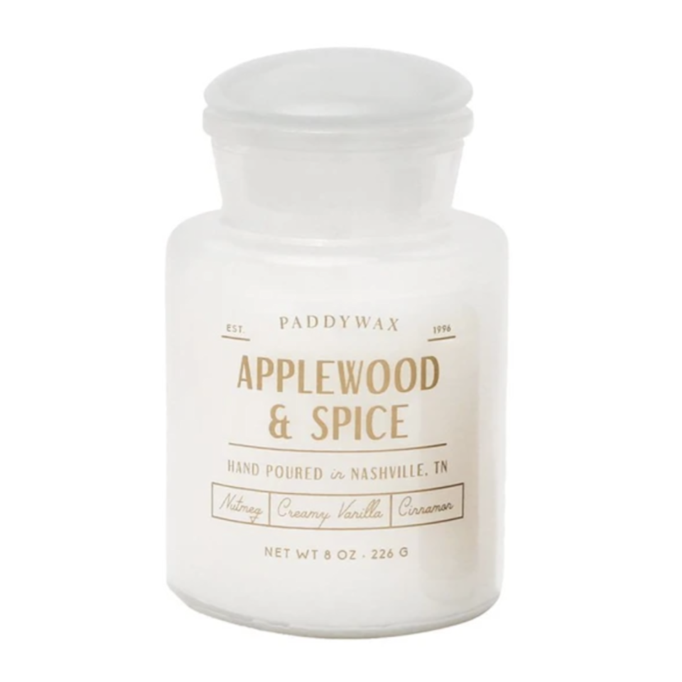 """This candle smells like your first apple cider of the season, fresh from the orchard with a generous sprinkle of cinnamon, clove, and nutmeg. Its surprising notes of sweet balsam and patchouli take what could have been a plain apple candle to greater heights. $25, Paddywax. <a href=""""https://paddywax.com/products/farmhouse-applewood-and-spice?"""" rel=""""nofollow noopener"""" target=""""_blank"""" data-ylk=""""slk:Get it now!"""" class=""""link rapid-noclick-resp"""">Get it now!</a>"""