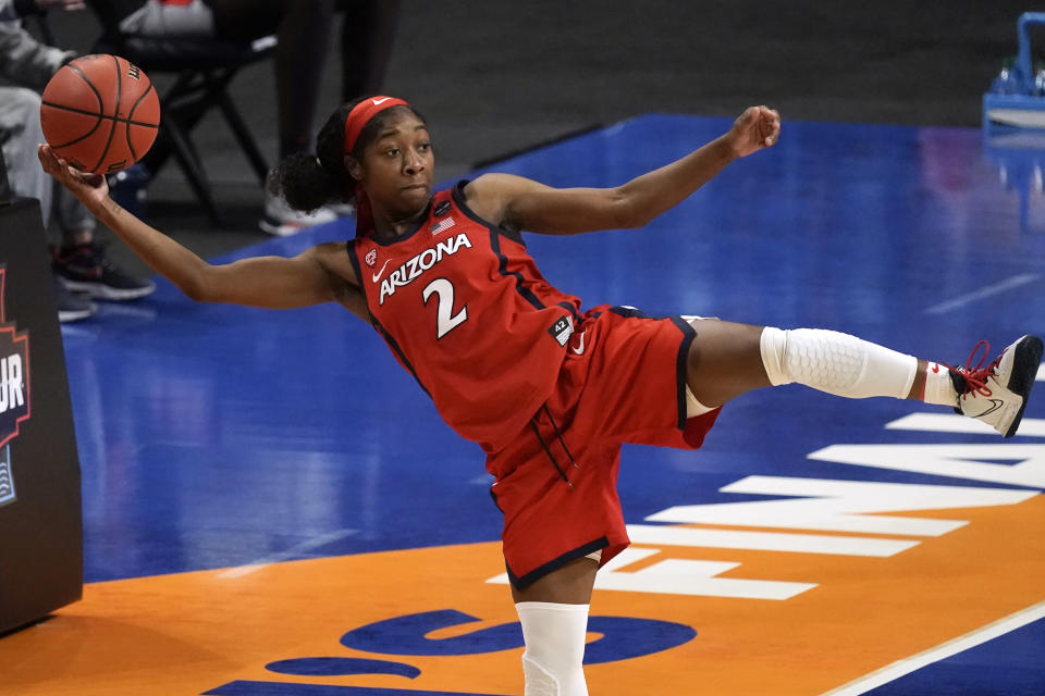 Arizona guard Aari McDonald (2) saves the ball from going out of bounds during the second half of a women's Final Four NCAA college basketball tournament semifinal game against Connecticut Friday, April 2, 2021, at the Alamodome in San Antonio. (AP Photo/Morry Gash)