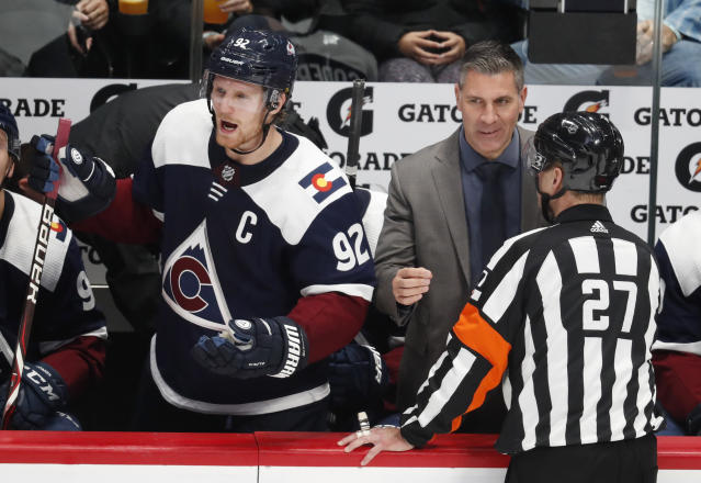 Colorado Avalanche left wing Gabriel Landeskog, left, yells at officials as coach Jared Bednar confers with official Eric Furlatt after an Avalanche goal was denied after review during the third period of an NHL hockey game against the Nashville Predators Wednesday, Nov. 7, 2018, in Denver. Nashville won 4-1. (AP Photo/David Zalubowski)