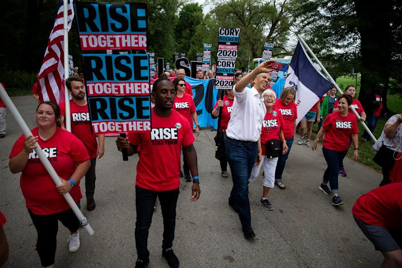 New Jersey Senator and 2020 Democratic presidential candidate Cory Booker leads his march into the Polk County Democrats Steak Fry in Water Works Park on Saturday, Sept. 21, 2019 in Des Moines.