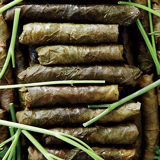 """<p>For his supertasty vegetarian stuffed grape leaves, chef Scott Conant makes a simple rice filling with onion, tomato paste, parlsey and a bit of dried mint.</p> <p> <a href=""""https://www.foodandwine.com/recipes/scott-conant-stuffed-grape-leaves"""">Go to Recipe</a></p>"""