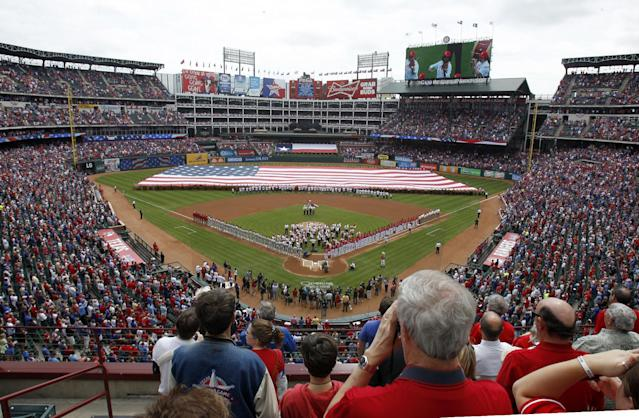 The Fort Worth Symphony Orchestra performs at Globe Life Park before an opening day baseball game between the Texas Rangers and the Philadelphia Phillies, Monday, March 31, 2014, in Arlington, Texas. (AP Photo/Kim Johnson Flodin)