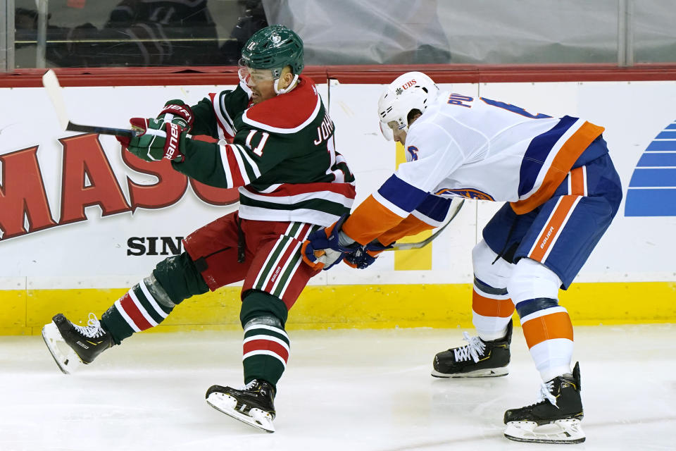 New York Islanders defenseman Ryan Pulock (6)uses his stick to upend New Jersey Devils left wing Andreas Johnsson (11) during the second period of an NHL hockey game, Tuesday, March 2, 2021, in Newark, N.J. (AP Photo/Kathy Willens)