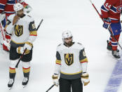 Vegas Golden Knights' Keegan Kolesar, left, and Alex Tuch skate off the ice after the team's loss to the Montreal Canadiens in overtime in Game 3 of an NHL hockey semifinal series, Friday, June 18, 2021, in Montreal. (Paul Chiasson/The Canadian Press via AP)
