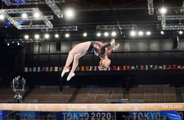 Ellie Black competes in the balance beam during the Tokyo 2020 Olympic Games on Sunday. She is out of the all-around final after spraining her ankle in training. (Leah Hennel/COC/The Canadian Press - image credit)