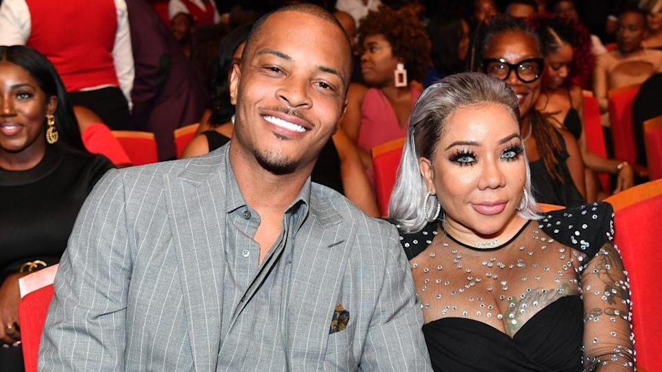 """T.I. (L) and his wife Tiny arrive at the premiere of """"Identity Thief"""" at the Village Theatre on Feb. 4, 2013 in Los Angeles, California. (Photo by Kevin Winter/Getty Images)"""